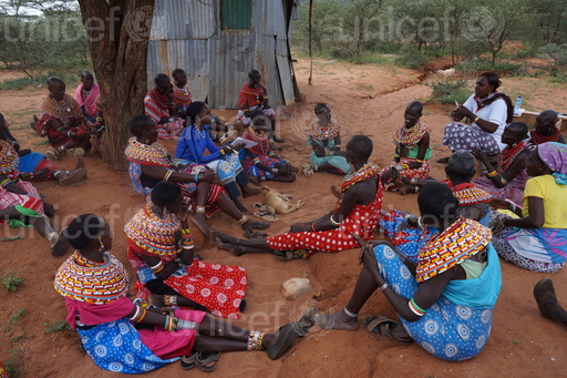 On 13th January 2016, (wearing white) volunteer Elizabeth Lemoyog speaks during a women's public gathering and dialogue forum in Kiltamany village located in Waso ward, Archer's post Samburu East Sub County in Samburu County. The public gathering and dialogue forum was facilitated by UNICEF and PCF. In this forum women stand up and said NO to FGM/C and child marriage. They suggested every women to approach men of their family regarding on FGM/C and child marriage so they have solutions without conflicting with their community men including brothers and husbands. UNICEF and Pastoralist Child Foundation programme on accelerating abandonment of Female genital Mutilation/Cutting (FGM/C) and Child marriage in six villages of Waso ward in Archer's Post-Samburu county through community mobilization, education, inter-generational dialogue and capacity development of duty bearers.